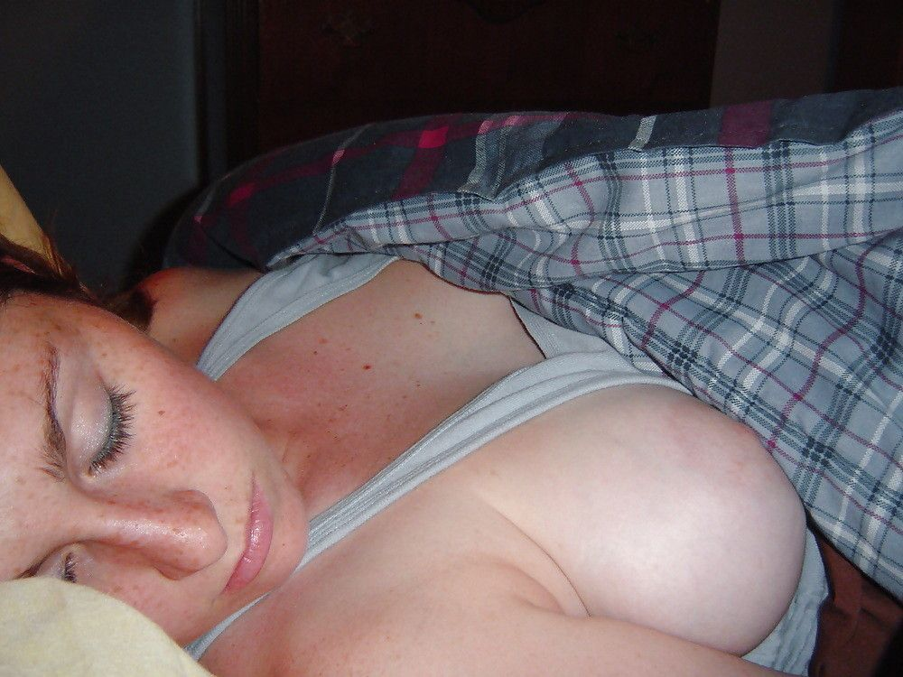 Softly fondling the tit of a sleeping roommate